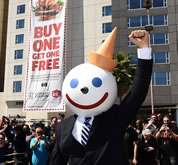 Fast food icon Jack, of Jack in the Box, makes a rare public appearance to celebrate capturing the World Record title for the world's Largest coupon. Measured at a staggering 80 feet tall by 25 feet wide, the world's Largest coupon was first redeemed for a buy one, get one free (BOGO) Buttery Jack burger by Jack himself, along with members of the Los Angeles community, at Jack in the Box's Hollywood restaurant.