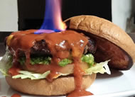 ": A Washington, Iowa smokehouse owner has created the world's hottest burger. Xtreme Smokehouse and Grill owner Loren Gingrich says his newest creation, the ""Hellfire Burger,"" has a rating of more than one million on the Scoville heat scale. A single jalapeno pepper is rated around five thousand on the heat scale."